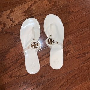 Tory Burch jelly flip flop sandals. White w/ gold